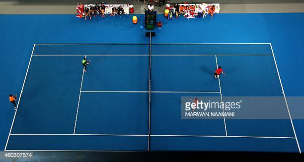 French Gael Monfis and Indian Rohan Bopanna of the Indian Aces play against Brazilian Bruno Soares and Australian Layton Hewitt of the Singapore...