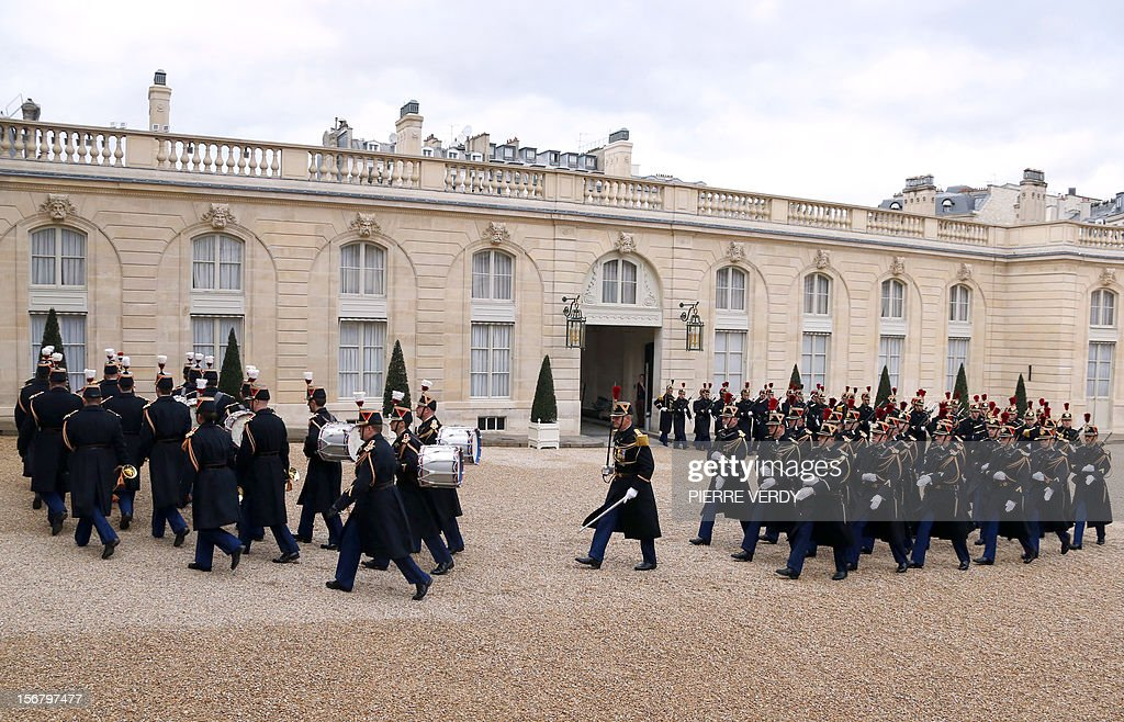 French Garde Republicaine (French honor Guard) arrive in the yard of the Elysee presidential Palace to welcome a guest of France's President, on November 21, 2012.