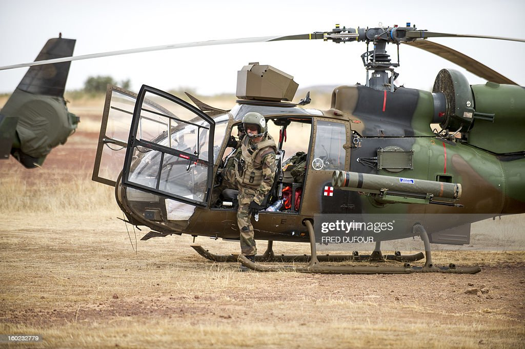A French Gazelle military helicopter, flying back from the city of Timbuktu, arrives at the French army base camp airport on January 28, 2013 in Sevare. French forces are advancing towards Mali's Islamist-held north after taking up positions in the towns of Niono and Sevare, a spokesman for the French military operation codenamed Serval said January 28, 2013. Sevare has a strategically important airport which could help serve as a base for operations further north. It is about 630 kilometres north-east of Bamako.