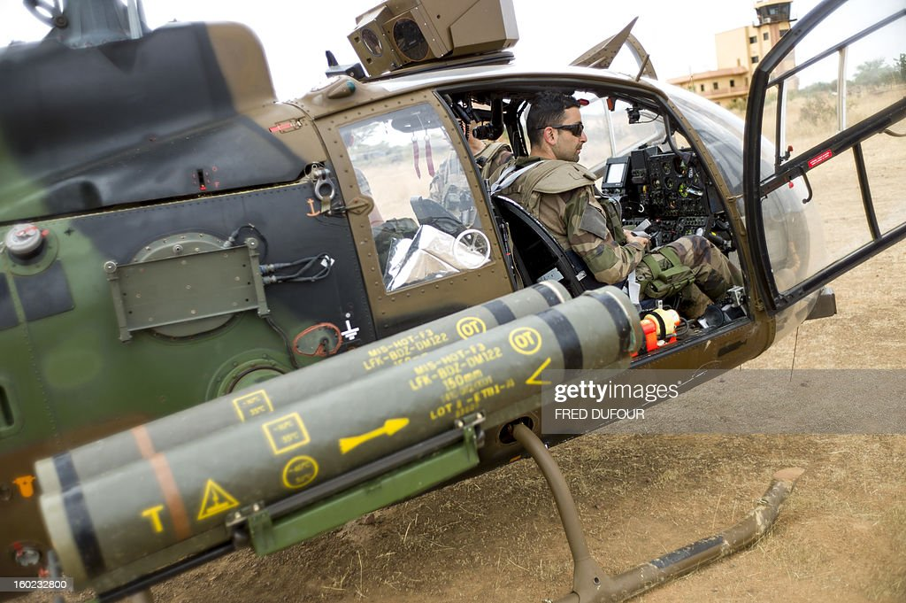 A French Gazelle military helicopter, flying back from the city of Timbuktu, arrives at the French army base camp airport on January 28, 2013 in Sevare. French forces are advancing towards Mali's Islamist-held north after taking up positions in the towns of Niono and Sevare, a spokesman for the French military operation codenamed Serval said January 28, 2013. Sevare has a strategically important airport which could help serve as a base for operations further north. It is about 630 kilometres north-east of Bamako. AFP PHOTO / FRED DUFOUR