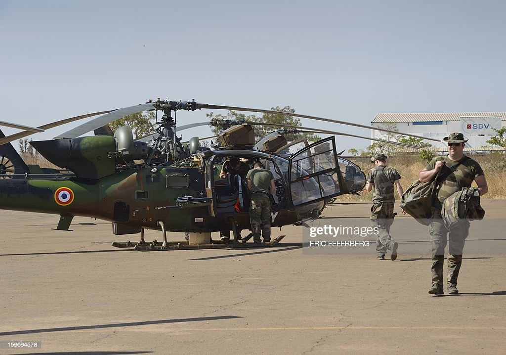 French Gazelles helicopters from the 5th RHC (Combat Helicopter Regiment) are parked on the 101 airbase near Bamako on January 18, 2013. France now has 1,800 troops on the ground in Mali, inching closer to the goal of 2,500 it plans to deploy in its African former colony, Defence Minister Jean-Yves Le Drian said today. That was 400 more than a day earlier, said the minister as he met with French special forces in the western port of Lorient. The troops have been sent to help the Malian army regain control of the north from Islamist groups.