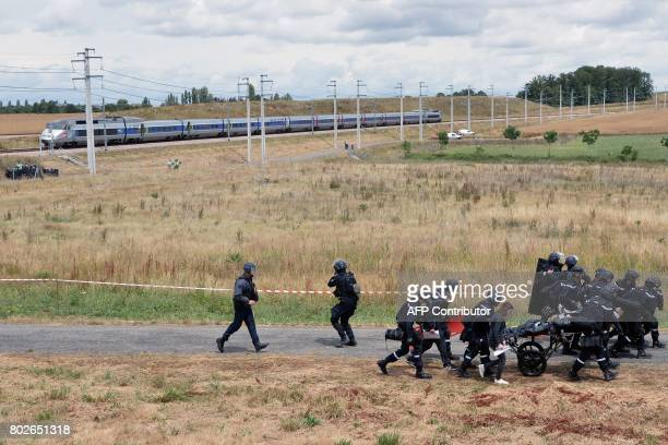 French gendarme and police officers take part in a simulation of a terror attack during a training exercise of the Civil Security to test the...