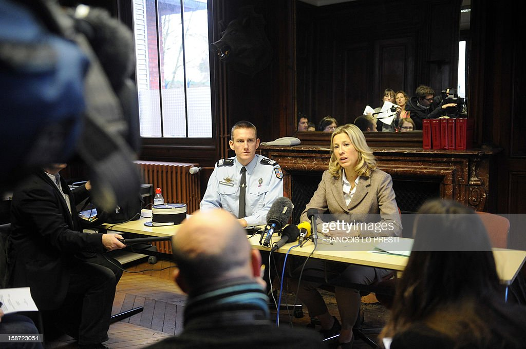 French Gendarme chief of station Mickael Nmery (C) and French prosecutor for Compiegne Ulrika Delaunay-Weiss speak to the press during a search for missing teen Bruno on December 26, 2012 in Ribecourt-Dreslincourt one week after the Down Syndrome affected 17 year old disappeared from the Compiegne region. AFP PHOTO / FRANCOIS LO PRESTI
