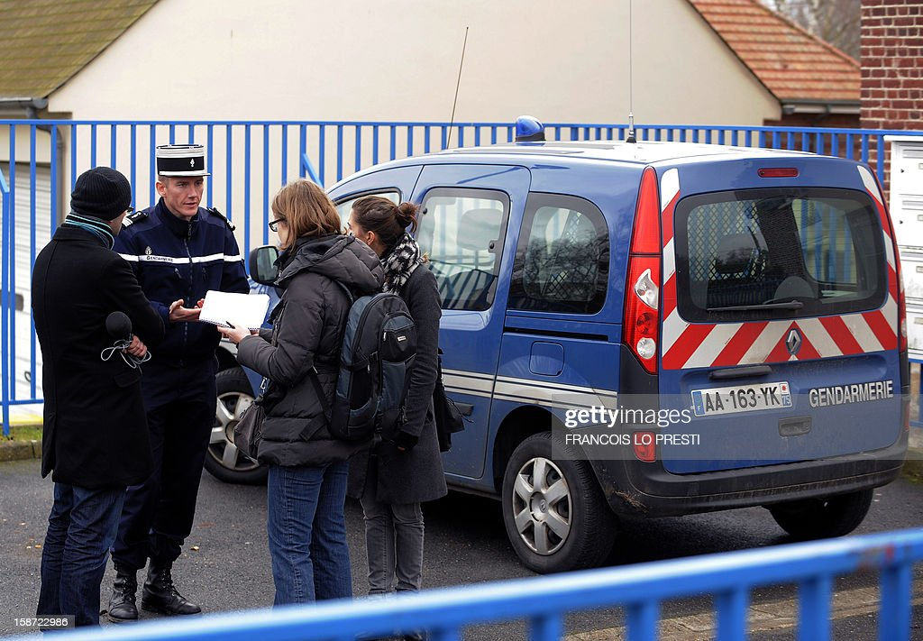 French Gendarme chief of station Mickael Nmery speaks to the press during a search for missing teen Bruno on December 26, 2012 in Ribecourt-Dreslincourt one week after the Down Syndrome affected 17 year old disappeared from the Compiegne region. AFP PHOTO / FRANCOIS LO PRESTI