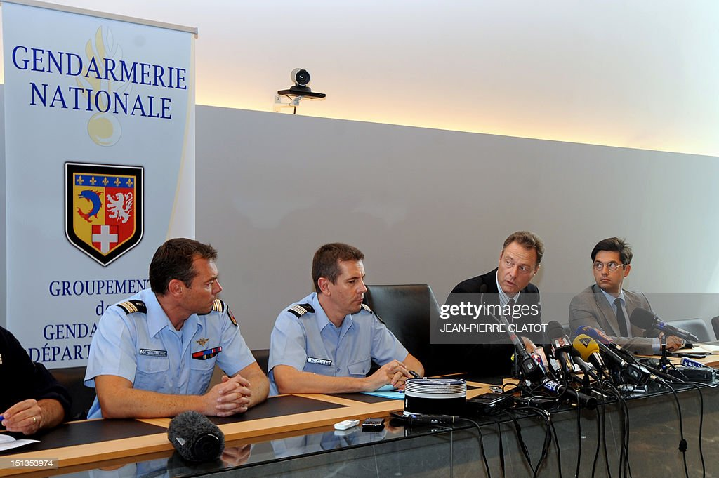 French gendarme colonel Benoit Vinneman (L), lieutenant colonel Bertrand Francois (2ndR) and Haute-Savoie prefect Georges-François Leclerc (R) listen to French Annecy's prosecutor, Eric Maillaud (2ndR) giving a press conference at the courthouse of the southeastern French city of Annecy on Septembre 6, 2012, after four people were shot dead in or close to a British-registered car that was found in a forest car park on the edge of the French Alpine village of Chevaline. The car, a BMW, contained the bodies of a man, in the front, and two women who were seated in the back, police said.