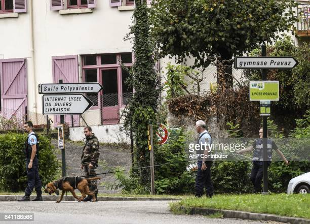 French gendarme dog unit searches for evidence on August 31 2017 in front of the village hall in PontdeBeauvoisin eastern France after the...