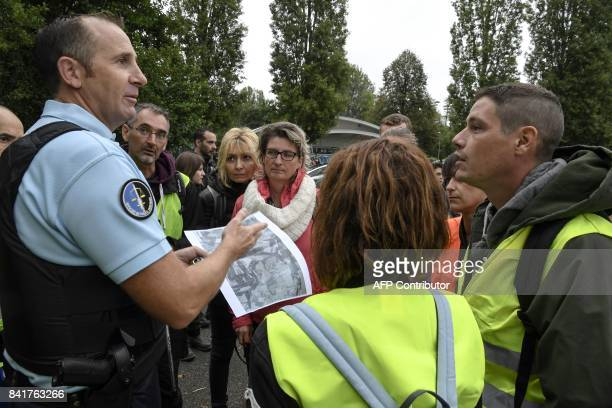 A French gendarme gives instructions to volunteers before a research operation with a group of citizens seven days after Maelys was reported missing...