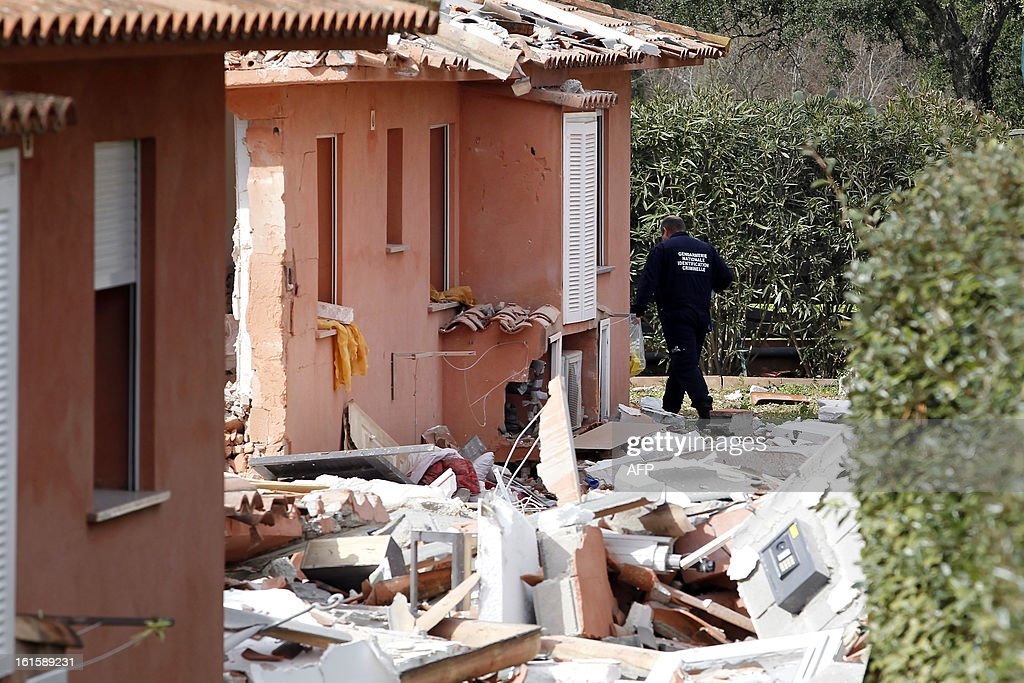 A French Gendarme investigates on the area of a house destroyed by a blast, injuring a man and a child, on February 12, 2013, in Porto-Vecchio, in the French Mediterranean island of Corsica. The reasons of the blast are still unknown. AFP PHOTO / PASCAL POCHARD-CASABIANCA