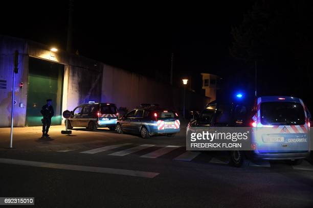 A French gendarme stands as vehicles of Gendarmerie and special forces wait to enter the Ensisheim prison eastern France on June 4 as a prison warden...