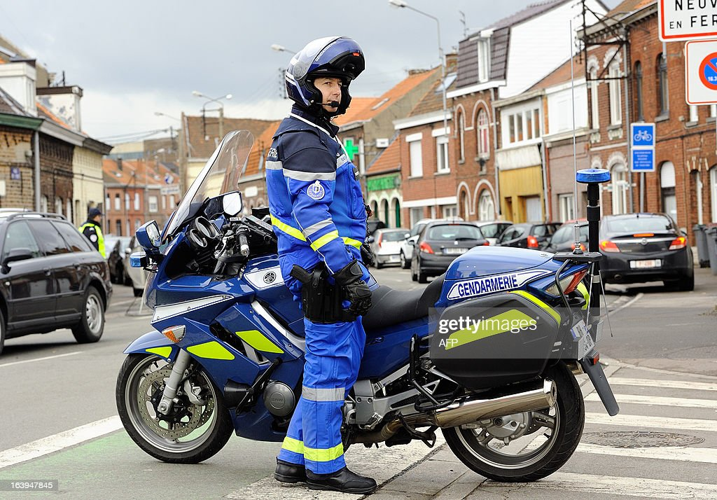 A French gendarme stands by his motorbike during a road traffic control with Belgian counterparts on March 18, 2013 near the Belgian border in Tourcoing, northern France, after a Franco-Belgian cooperation agreement between police and customs has been signed today.
