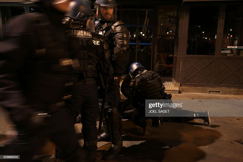 French Gendarmerie arrest a person as they clear the Place de la Republique in Paris during a protest by the Nuit Debout, or 'Up All Night' movement who have been rallying against the French government's proposed labour reforms early on April 29, 2016. Twenty-seven people were arrested and 24 detained during the overnight clashes in the French capital as the police dispersed the protesters who began their began movement on March 31 in opposition to the government's proposed labour reforms.