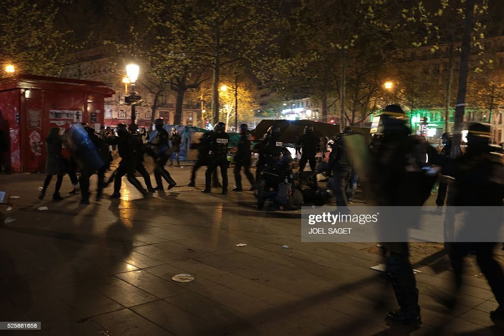 French Gendarmerie clear the Place de la Republique in Paris during a protest by the Nuit Debout, or 'Up All Night' movement who have been rallying against the French government's proposed labour reforms early on April 29, 2016. Twenty-seven people were arrested and 24 detained during the overnight clashes in the French capital as the police dispersed the protesters who began their began movement on March 31 in opposition to the government's proposed labour reforms.