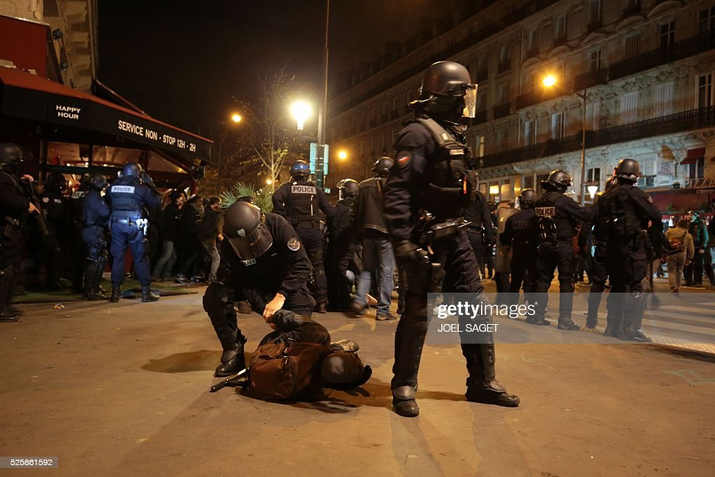 French Gendarmerie detain a man as they clear the Place de la Republique during a protest by the Nuit Debout, or 'Up All Night' movement who have been rallying against the French government's proposed labour reforms early on April 29, 2016. Twenty-seven people were arrested and 24 detained during the overnight clashes in the French capital as the police dispersed the protesters who began their began movement on March 31 in opposition to the government's proposed labour reforms.