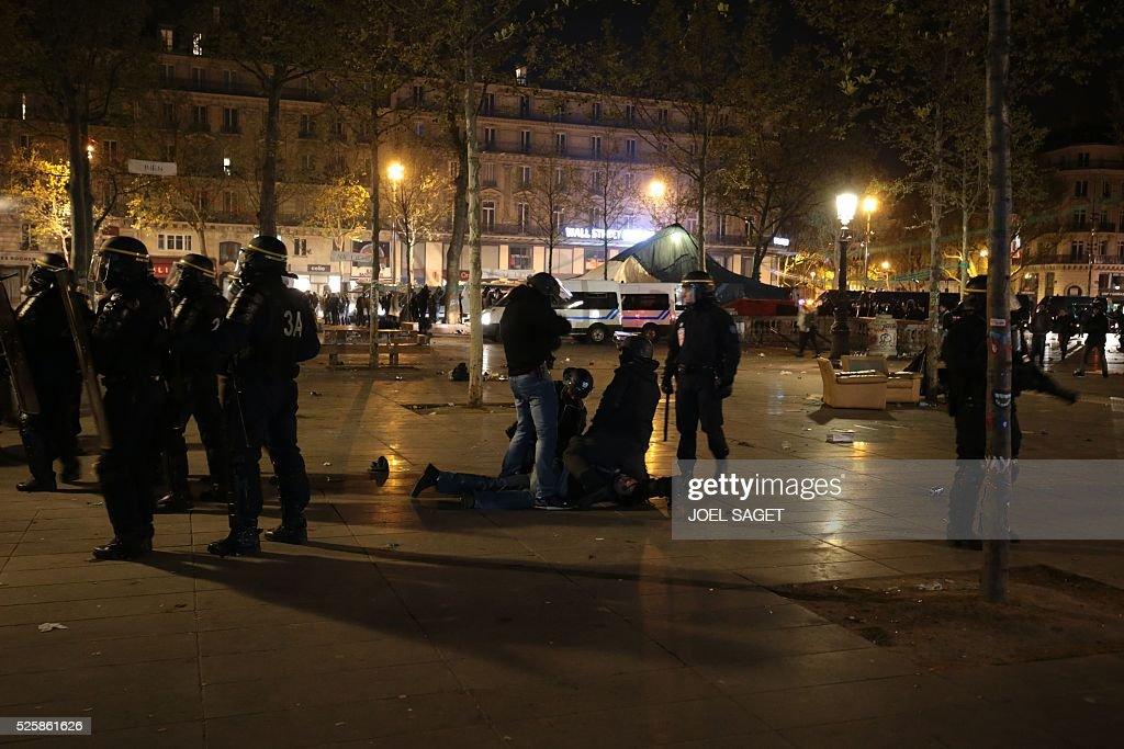 French Gendarmerie detain a man as they clear the Place de la Republique in Paris during a protest by the Nuit Debout, or 'Up All Night' movement who have been rallying against the French government's proposed labour reforms early on April 29, 2016. Twenty-seven people were arrested and 24 detained during the overnight clashes in the French capital as the police dispersed the protesters who began their began movement on March 31 in opposition to the government's proposed labour reforms.