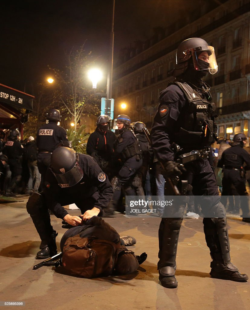 French Gendarmerie arrest a peson as they clear the Place de la Republique in Paris during a protest by the Nuit Debout, or 'Up All Night' movement who have been rallying against the French government's proposed labour reforms early on April 29, 2016. Twenty-seven people were arrested and 24 detained during the overnight clashes in the French capital as the police dispersed the protesters who began their began movement on March 31 in opposition to the government's proposed labour reforms.