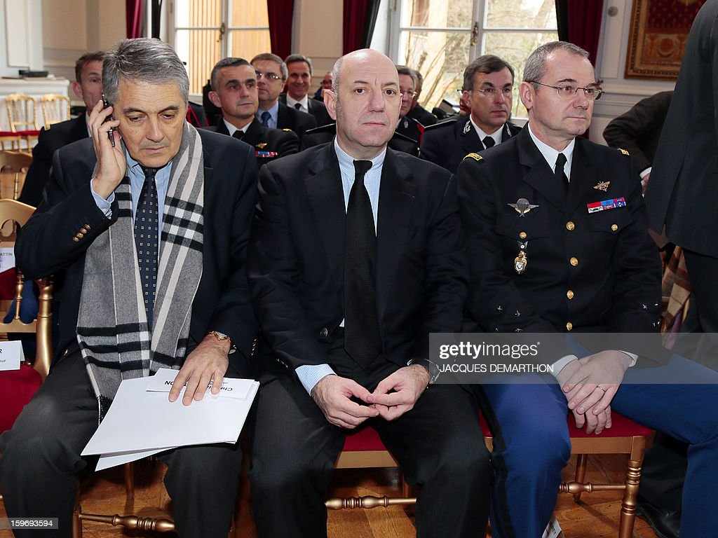 French gendarmerie general major Richard Lizurey (R) , Philippe Klayman (C) head of the central direction of the Republican Security Companies (CRS) and Christian Lothion, general director of French judiciary police attend the presentation by French Interior minister of the report of the past year and the prospects of the security policy for the upcoming yearon January 18, 2013 at the ministry in Paris.