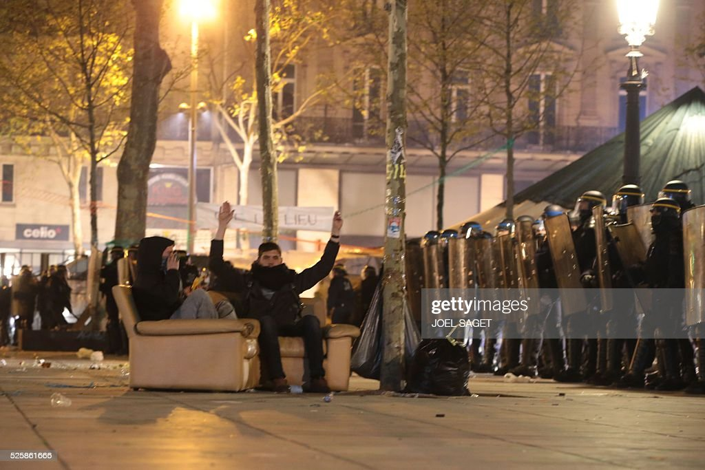 French Gendarmerie stand in line as they begin to clear the Place de la Republique in Paris during a protest by the Nuit Debout, or 'Up All Night' movement who have been rallying against the French government's proposed labour reforms early on April 29, 2016. Twenty-seven people were arrested and 24 detained during the overnight clashes in the French capital as the police dispersed the protesters who began their began movement on March 31 in opposition to the government's proposed labour reforms.