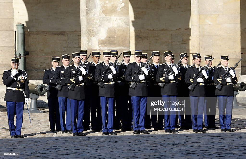A French Gendarmerie unit stands guard on February 18, 2013 at the Hotel des Invalides in Paris, during a memorial cemerony honoring gendarmes who died during service. French Interior minister Manuel Valls reviewed units of the French Gendarmerie during this memorial cemerony.