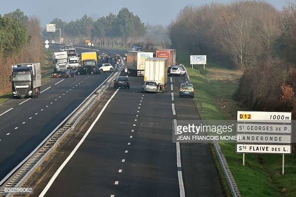 French gendarmes and emergency workers arrive a the site of a car accident involving around fifty vehicles which killed 5 people and injured 20 on...