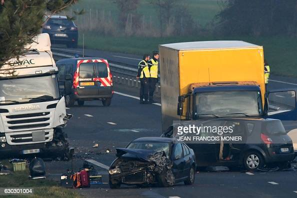 French gendarmes and emergency workers work at the site of a car accident involving around fifty vehicles which killed 5 people and injured 20 on the...