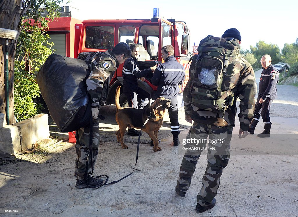 French gendarmes and firemen prepare on October 29, 2012 to search for a 12-year-old British boy, who disappeared on October 27, on Porquerolles island, southeastern France. Sixty soldiers and three civil security dog-handlers from Brignoles are paricipating in the search.