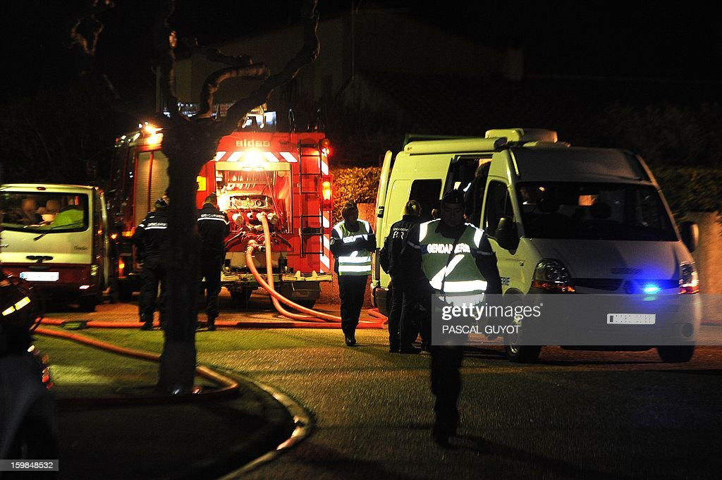 French Gendarmes and firemen work outside a house where five people were found dead on January 21, 2013 in Garons, near Nimes, southern France. The bodies of two adults and three children were found by firemen after a neigbour called for a fire in the afternoon.