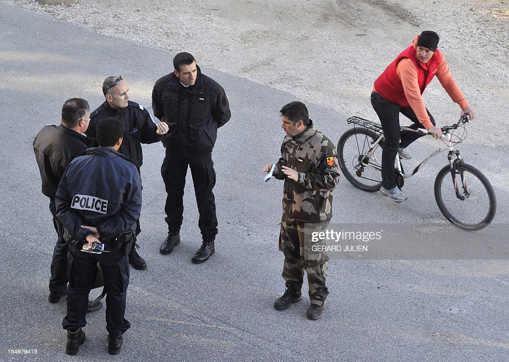 French gendarmes and policemen prepare on October 29, 2012 to search for a 12-year-old British boy, who disappeared on October 27, on Porquerolles island, southeastern France. Sixty soldiers and three civil security dog-handlers from Brignoles are paricipating in the search.