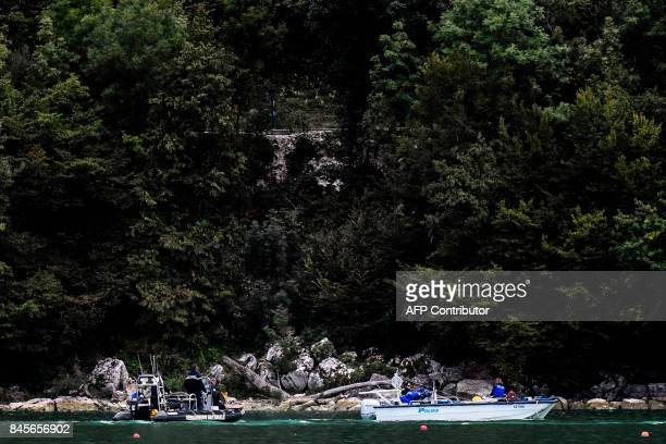 French gendarmes and Swiss police scour the Aiguebelette lake on September 11 2017 in AiguebeletteleLac eastern France as part of the search...
