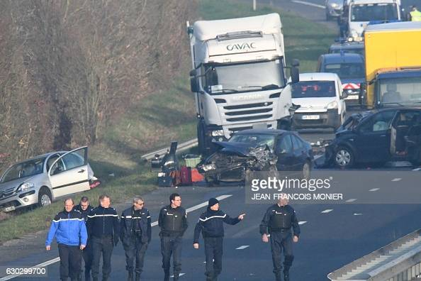French gendarmes arrive a the site of a car accident involving around fifty vehicles which killed 5 people and injured 20 on the departmental road...