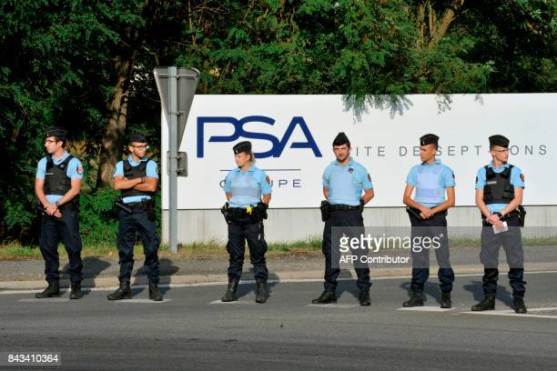 French gendarmes block the entrance of the foundry of SeptFons a site of PSA in DompierresurBesbre to employees from GMS auto parts manufacturer and...