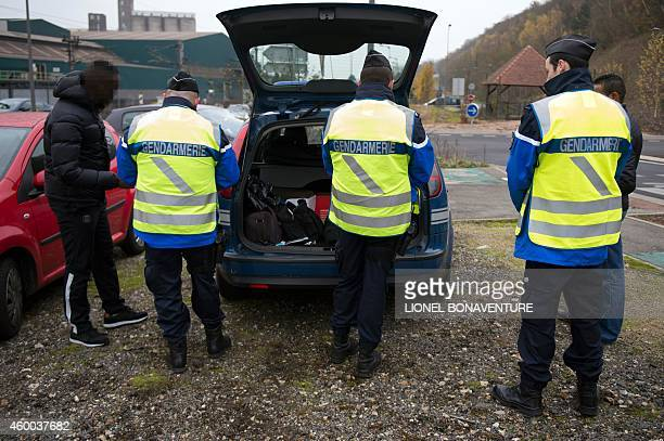 French gendarmes control a driver's documents and check his car on December 4 2104 in BonnieressurSeine during a saliva drug testing operation Police...