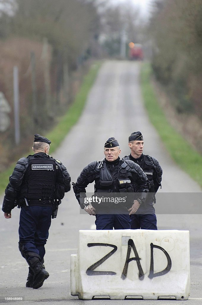 French gendarmes control the access to a music festival against a project of international airport on January 4, 2013 in Notre-Dame-des-Landes, western France. The project was signed in 2010 and the international airport is supposed to open in 2017 near the city of Nantes.