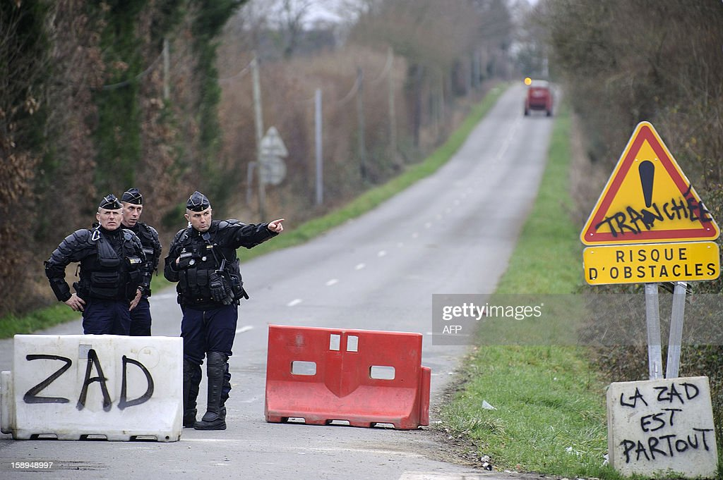 French gendarmes control the access to a music festival against a project of international airport on January 4, 2013 in Notre-Dame-des-Landes, western France. The project was signed in 2010 and the international airport is supposed to open in 2017 near the city of Nantes. AFP PHOTO JEAN-SEBASTIEN EVRARD