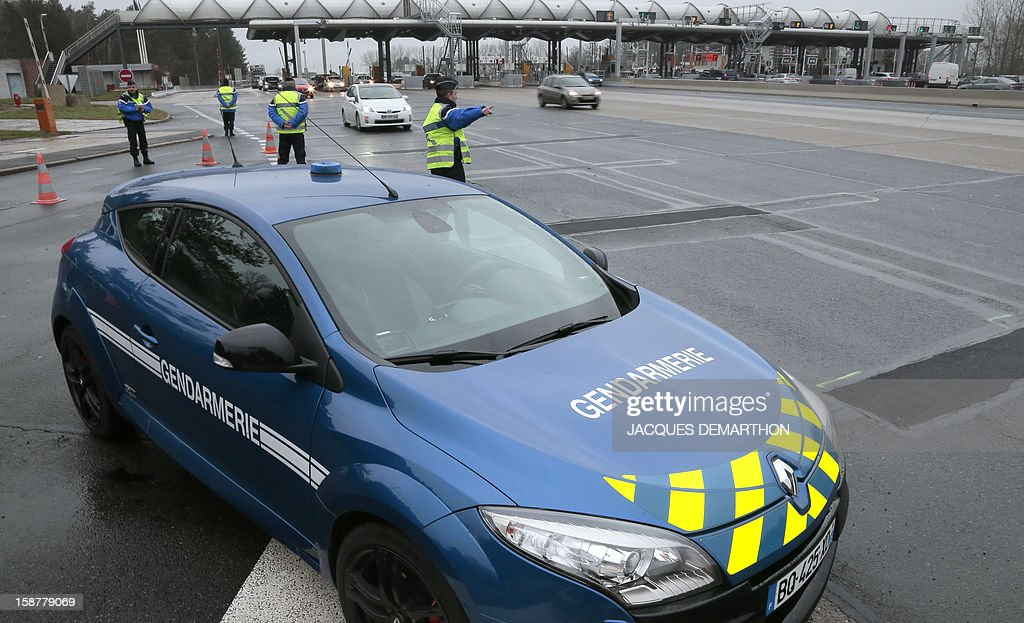 French gendarmes control the traffic on December 28, 2012 at the Fleury-en-Bière's toll.