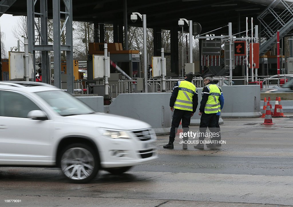 French gendarmes control vehicles on December 28, 2012 at the Fleury-en-Bière's toll.