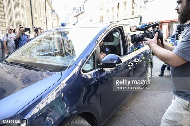 French gendarmes drive vehicles carrying Marcel Jacob and his wife Jacqueline to arrive at the courthouse of Dijon on June 20 2017 before a hearing...