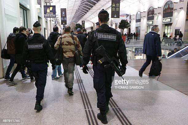 French gendarmes enforcing the Vigipirate plan France's national security alert system patrol on November 19 2015 in a railway station Paris France...