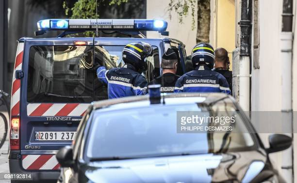 French gendarmes escort vehicles carrying Marcel Jacob and his wife Jacqueline before a hearing at the courthouse of Dijon on June 20 2017 as part of...