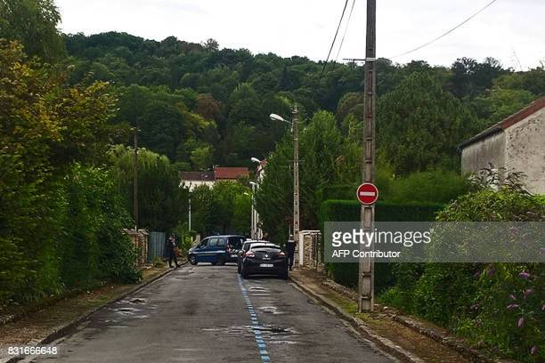 French gendarmes investigate a house in La FertesousJouarre on August 15 the day after its resident provoked a car crash into a pizza restaurant...