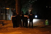 French gendarmes investigate suspected gunfire in Persan near BeaumontsurOise on July 22 following clashes between residents and police over the...