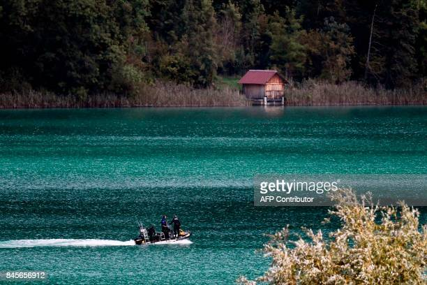French gendarmes on a speed boat scour the Aiguebelette lake on September 11 2017 in AiguebeletteleLac eastern France as part of the search...
