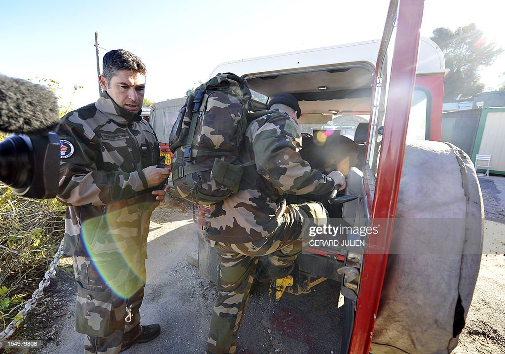French gendarmes prepare on October 29, 2012 to search for a 12-year-old British boy, who disappeared on October 27, on Porquerolles island, southeastern France. Sixty soldiers and three civil security dog-handlers from Brignoles are paricipating in the search.