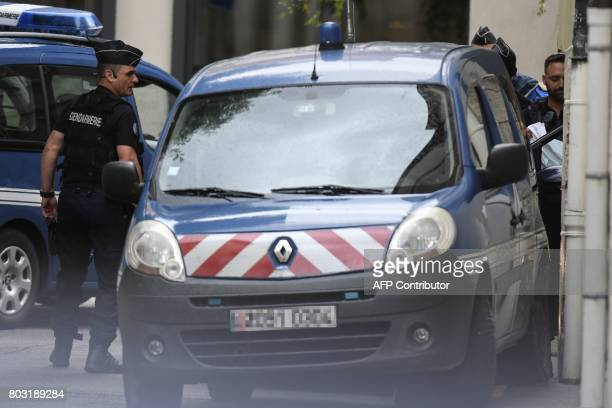 French gendarmes prepare to escort a vehicle carrying Murielle Bolle outside the courthouse of Dijon on June 29 2017 where she is being heard for...