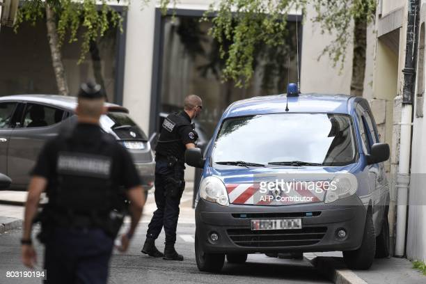 French gendarmes prepare to escort a vehicle carrying Murielle Bolle outside the courthouse of Dijon on June 29 where she is being heard for...