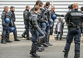 French gendarmes round up and evict migrants who were living in a camp near the Channel Tunnel in Calais northern France on June 2 2015 Police...