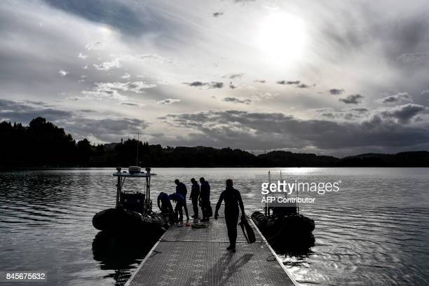 French gendarmes scour the Aiguebelette lake on September 11 2017 in AiguebeletteleLac eastern France as part of the search operations to find a...