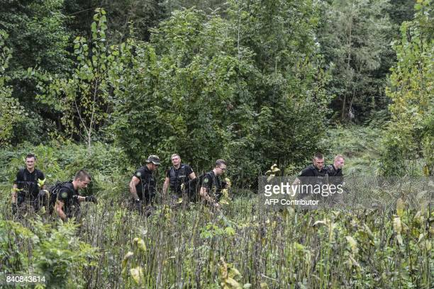 French gendarmes search for evidence in PontdeBeauvoisin on August 30 2017 after the disappearance of a 9yearold girl Police reinforcements arrived...
