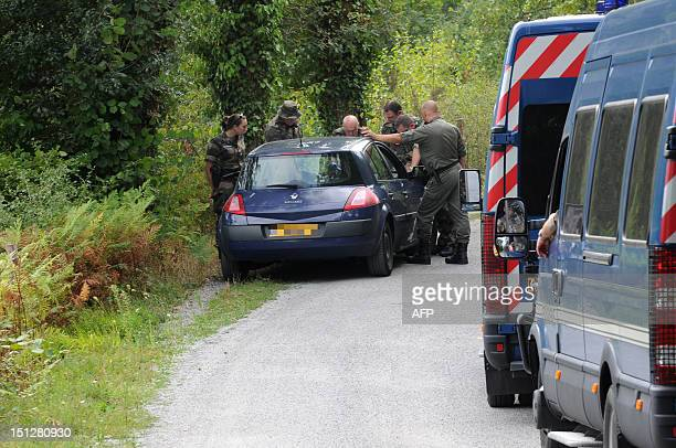 French gendarmes search for missing English expatriate Patricia Wilson through a heavily wooded area near the village of Sanvensa in southern France...