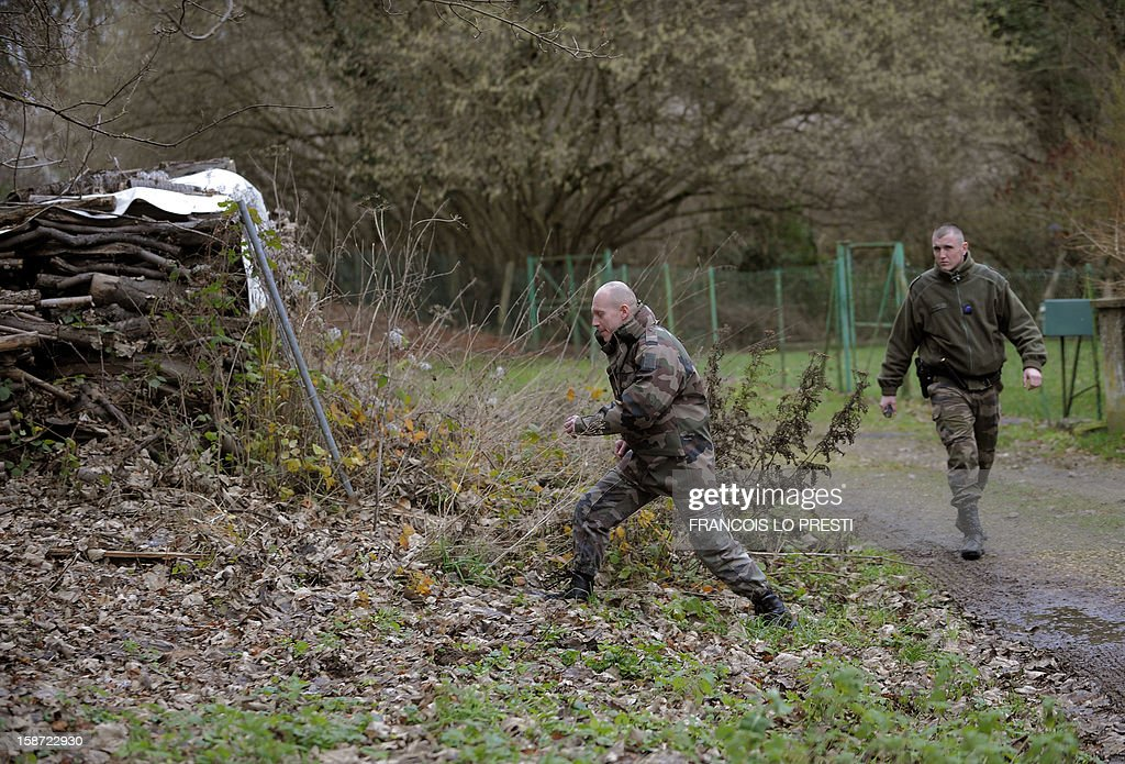 French Gendarmes search for missing teen Bruno on December 26, 2012 near Ribecourt-Dreslincourt one week after the Down Syndrome affected 17 year old disappeared from the Compiegne region.