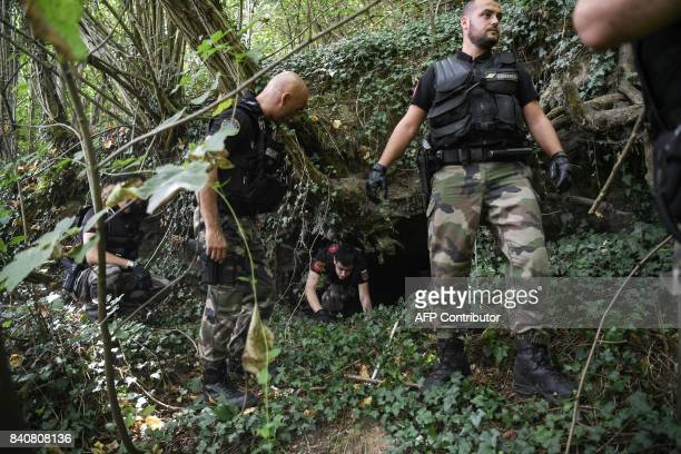 French gendarmes search through a forest around PontdeBeauvoisin eastern france on August 30 2017 after the disappearance of a 9yearold girl Police...